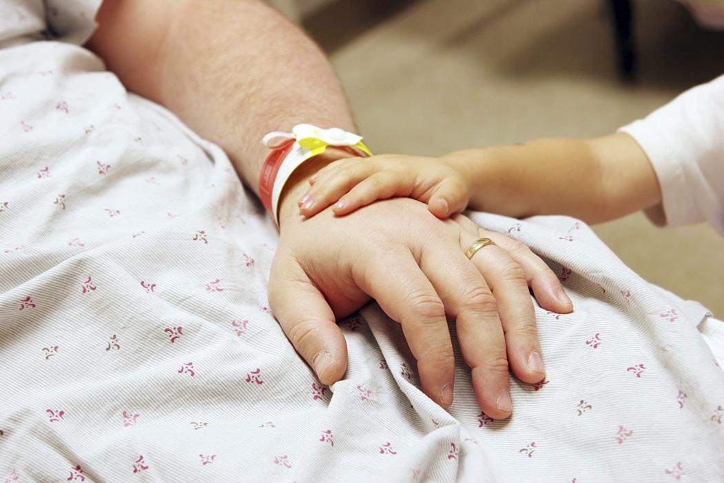 civl claim - Father child hospital comforting hands